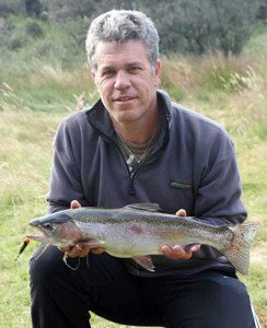 Pieter with his rainbow trout taken spin fishing on a black and gold Toby.