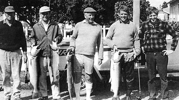 50 years of salmon fishing. A good morning's fishing back in March 1971. Black and white photograph of five anglers with their salmon catch.
