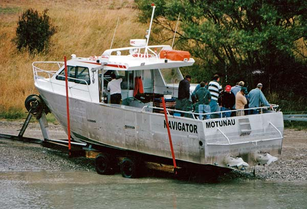 The magnificient vessel Navigator uses twin inboard jet units to navigate the shallow Motunau Bar. Here she has just returned with a crew of keen anglers.