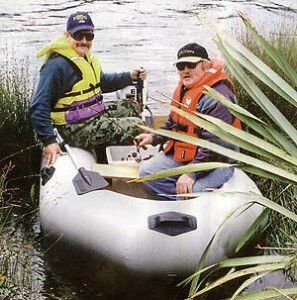 The author Allan Burgess at the helm and guide Brent Beadle in the bow at Lake Brunner.