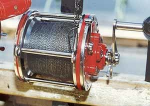 Penn Senator star drag reel spooled with braid for deep sea fishing.