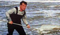 Tony Thomas dragging for whitebait in the surf at Okarito.