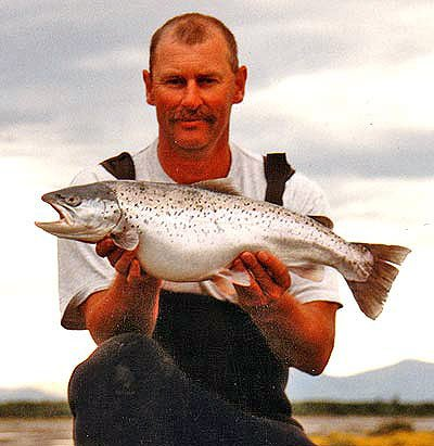 Leigh Tobeck with a very fat 7.5 pound searun brown trout taken in the Rangitata River. What a well fed fish! Photograph by Darryl French.