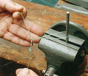 The job of tying droppers is made easier if you clamp an upturned screwdriver in a bench top vice.
