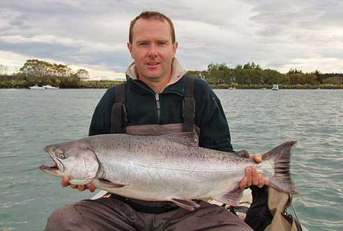 Greg with a big solid looking salmon from McIntoshes Hole back in 2007.