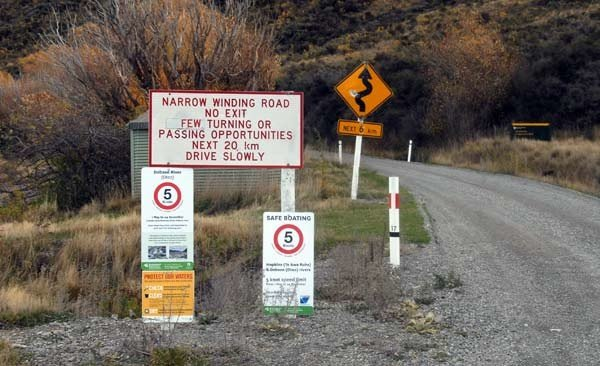 The sign at the southern end of Lake Ohau warns of the narrow winding road with few spots for passing vehicles coming the other way.