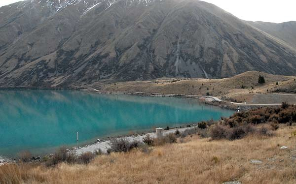 View of Lake Ohau from the southern end. The Ohau A intake and canal are just out of sight to the right of this picture. It can get very hot in summer and freezing cold in winter. Snow to the lake edge is not uncommon.