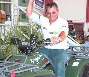 Morris Clark sits atop his prizes; a brand new Kawasaki 300cc quad bike. Rakaia Salmon Fishing Contest.