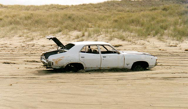 If you get caught on the beach when the tide is coming in you can end up with a car like this one!