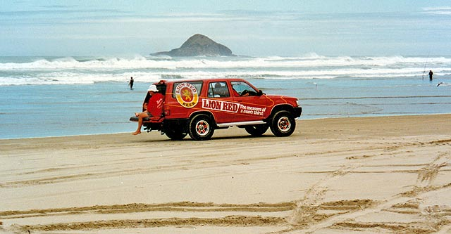 "The Lion Red sponsors drive up and down the beach giving away the ""product"" to contestants. Photograph: DJ Moresby."