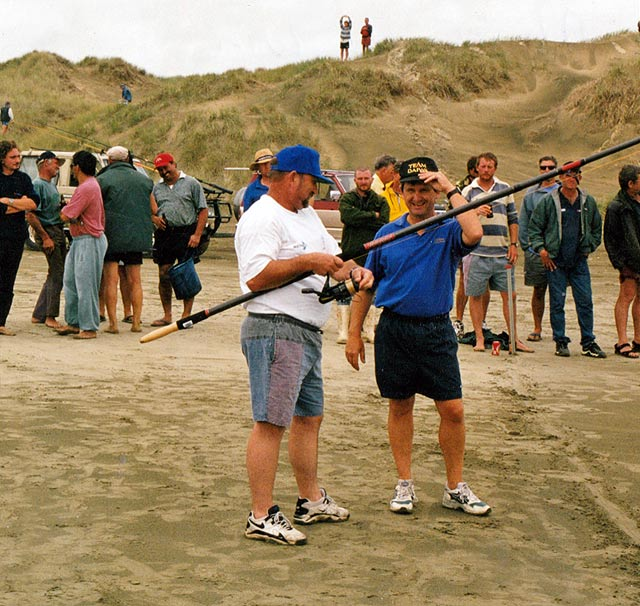 Peter Bryant of New Plymouth (left) about to win the Daiwa Dry- Land Distance Casting Competition. On the right is John Elliott who organized this event on behalf of Daiwa New Zealand.