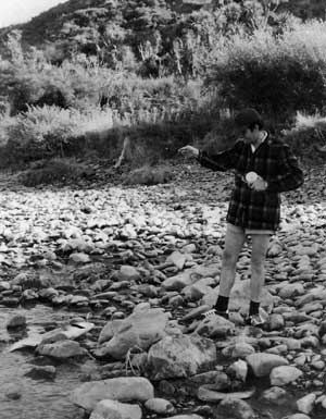 A salmon comes ashore on a baitcaster reel: Rakaia Gorge.