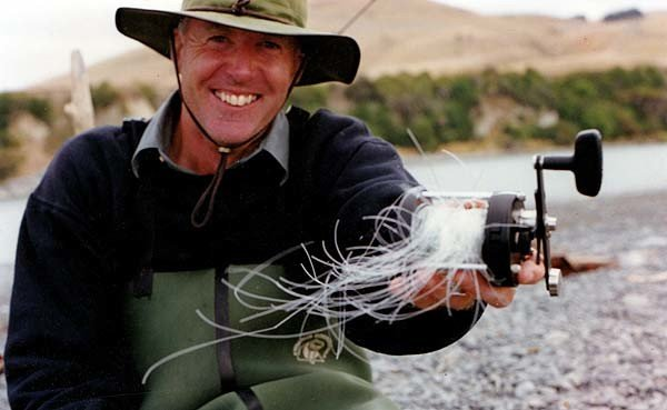 Still smiling. If haven't had one of these you might not be a true salmon angler yet! What an awful tangle. The reel looks to be an Abu Seven Sprint. But this can happen with any bait-caster reel.