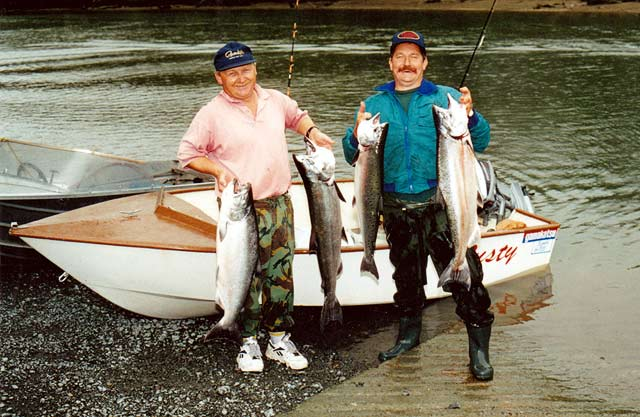 How to Catch Salmon. Lyndsay Bishop (left), and Allan Burgess with limit bags from the Waimakariri River.