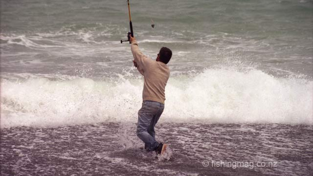 Casting out. Surfcasting at Nape Nape Beach.