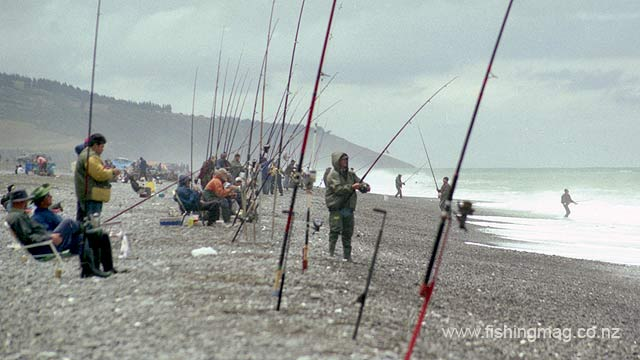 Surfcasters on Nape Nape Beach. The Hurunui River mouth is in the distance. Nape Nape Beach Surfcasting
