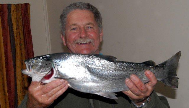 Allan Burgess with a bright silver sea-run brown trout.