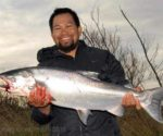 Anton Ortiz with a fresh run silver salmon from the Waimakariri River.