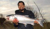 Anton Ortiz with a fresh run silver salmon from the Waimakariri River.
