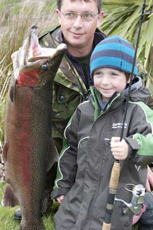 A very big rainbow trout caught by a youngster. Kids Learning to Fish.