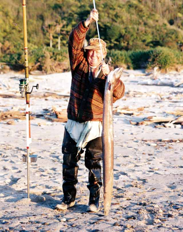 The late Joe Chidgey with a conger eel caught surfcasting at Mokihinui Gentle Annie Beach.