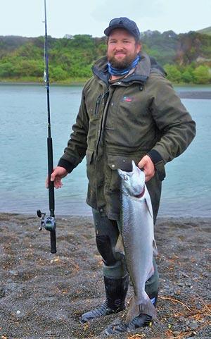Regan Harper with a fresh Hurunui River salmon. Photograph courtesy of Charles Smith.