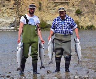 Nik Christidis and Charles Smith with limit bags from the Hurunui River mouth 22 March 2017. An old salmon angler's measure is if the tail drags along the stones when held like this through the gill plates, you know it's a good sized salmon. By that measure, these are small fish. Nevertheless, it also shows that top anglers will be catching fish every season regardless of the size of the salmon run!
