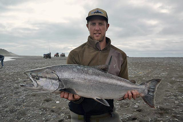 Sam Petrie with a good sized salmon from the Hurunui River. Photograph courtesy of Charles Smith.
