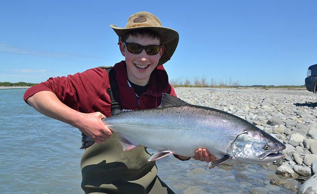 Simon Jones with a bright silver fresh sea-run salmon from the Rakaia River. Photograph courtesy of Charles Smith.