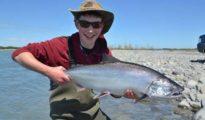 Simon Jones with a bright silver fresh sea-run salmon from the Rakaia River. Photograph courtesy of Charles Smith.