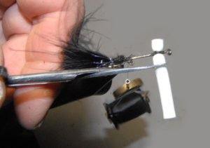 Black boobie fly. Under bind to the rear of the hook. Tie in the black marabou, then the end of the UV Straggle String. I cut the foam to match the opposite side. It is much easier than trying to hold and tie in tiny lengths of foam.