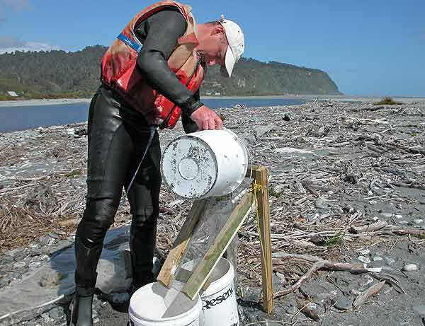The legs is this whitebait cleaning screen are pushed or hammered into the beach making a good stable stand, Okarito River, Westland.