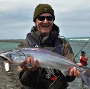 Mark Preston with a salmon caught during the 2016-2017 season. Photo courtesy of Charles Smith.