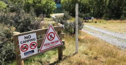 """Selwyn District Council """"No Camping"""" sign at Lake Selfe in the Canterbury High Country. Photograph by T.Austin. Featured image."""