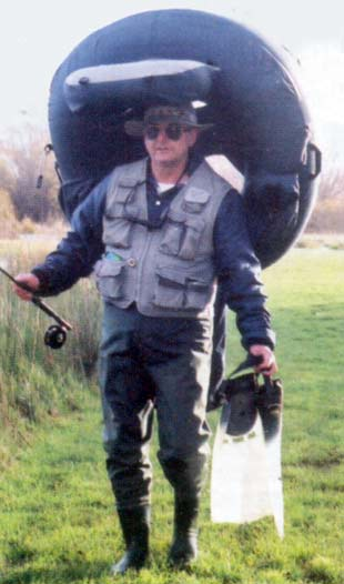 Carrying the tube to and from the lake. Your head fits into the centre of the backrest for comfort, and you could easily walk for a couple of kilometres like this. Float tubes.
