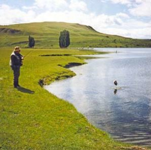 Monty Wright with the first trout of the day at Paddock Bay. Photo Selwyn Shanks.
