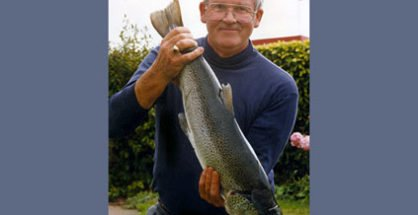 Ron Sim of Oamaru with an 11 lb brown trout he caught in Lake Wanaka at Fisherman's Bend. Ron caught it on a black Toby. Featured image.