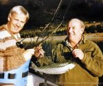 Evan Taylor and Monty Wright with Evan's nice rainbow taken while fly rod harling on Lake Hawea. Photo: Monty Wright.