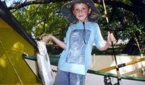 Samuel Wood, when aged just seven, with his first trout, a three and a quarter pound rainbow from Lake Alexandrina.