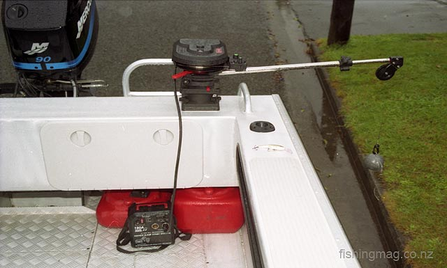Scotty electric downrigger model mounted on the transom of a McLay trailer boat. The use of a separate battery avoids any risk of a flat boat motor battery.