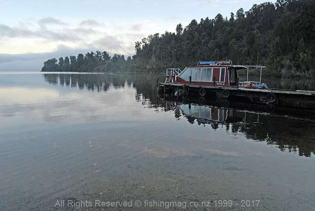 Glacier Country Lake Tours vessel at the southern end of Lake Mapourika. Glacier Country Lake Tours offer scenic lake trips and fishing charters.