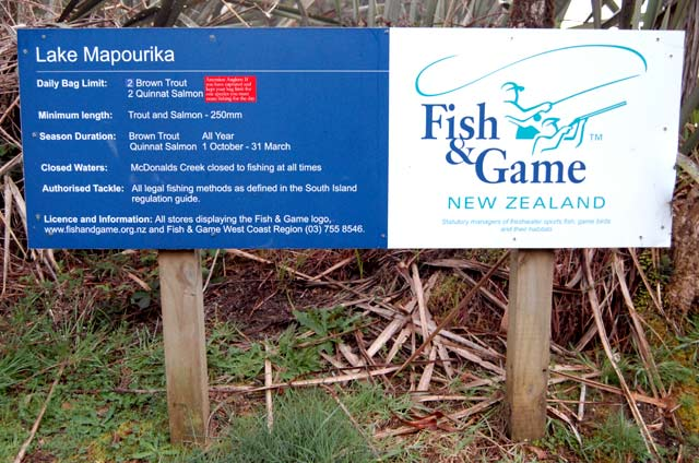 "Fish & Game sign at Lake Mapourika. The small red insert says, ""Attention Anglers: If you have captured and kept your bag limit for one species you must cease fishing for the day."