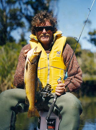 The author with a Hapuka River brownie. A quick photograph and back it goes. Photo Aaron Horrell.
