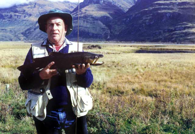 Monty with a 2.5kg jack from the pond behind, Central Otago. Fishing ponds.