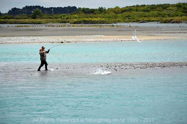 "Simon McMillan with a ""fish on"" in the lower Rakaia River.,2017-2018 Salmon Season."