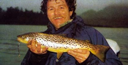 The author with a typical Lake Moeraki brown trout. The trout provide excellent sport on light spinning gear. Photo courtesy of Vern Harvey.