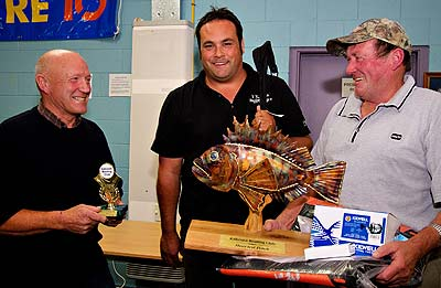 Prize for heaviest Sea Perch, Presented by Bruce Hills from Mitre 10 (left) and Anton Evans of Kaikoura Hunting and Fishing (centre) to Kevin Williams (right). Kaikoura Boating Club.