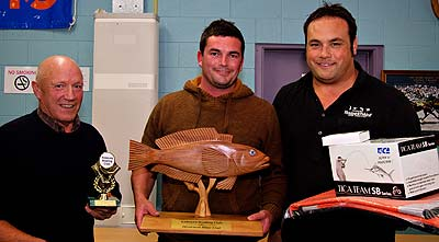 Prize for heaviest Blue Cod, Presented by Bruce Hills from Mitre 10 (left) and Anton Evans of Kaikoura Hunting and Fishing (right) to Chris Sowden (center). Kaikoura Boating Club.