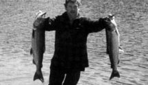 """Graeme """"The Butcher"""" Larsen at Lake Paringa. With a one fish limit, the smaller salmon was caught by his brother."""