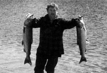"Graeme ""The Butcher"" Larsen at Lake Paringa. With a one fish limit, the smaller salmon was caught by his brother."